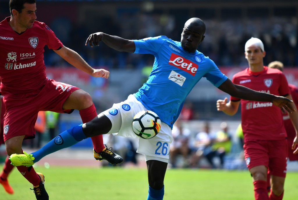 Napoli's French Senegalese defender Kalidou Koulibaly scores during the Italian Serie A football match Napoli vs Cagliari on October 1, 2017 at San Paolo stadium in Naples. / AFP PHOTO / ALBERTO PIZZOLI (Photo credit should read ALBERTO PIZZOLI/AFP/Getty Images)