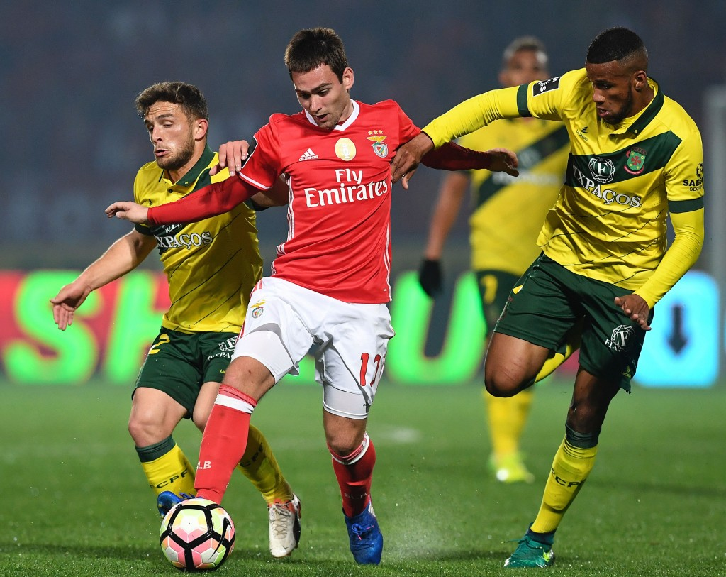 Benfica's Serbian forward Andrija Zivkovic (C) vies with Pacos de Ferreira's midfielder Pedrinho (L) and Brazilian defender Bruno Santos during the Portuguese league football match FC Pacos de Ferreira vs SL Benfica at the Capital do Movel stadium in Pacos de Ferreira on March 18, 2017. / AFP PHOTO / FRANCISCO LEONG (Photo credit should read FRANCISCO LEONG/AFP/Getty Images)
