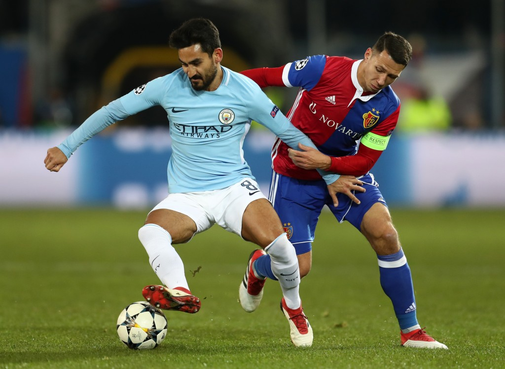BASEL, BASEL-STADT - FEBRUARY 13: Ilkay Gundogan of Manchester City is challenged by Marek Suchy of FC Basel during the UEFA Champions League Round of 16 First Leg match between FC Basel and Manchester City at St. Jakob-Park on February 13, 2018 in Basel, Switzerland. (Photo by Catherine Ivill/Getty Images)