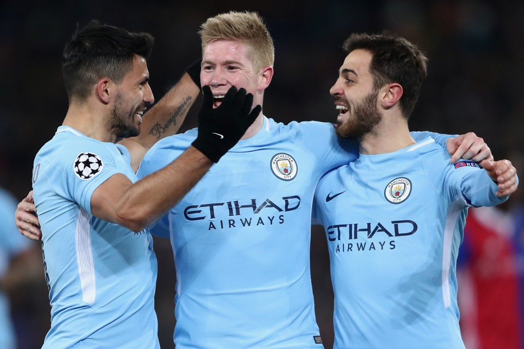 BASEL, SWITZERLAND - FEBRUARY 13: Sergio Aguero of Manchester celebrates his team's third goal with team mates Kevin de Bruyne and Bernardo Silva (L-R) during the UEFA Champions League Round of 16 First Leg match between FC Basel and Manchester City at St. Jakob-Park on February 13, 2018 in Basel, Switzerland. (Photo by Alex Grimm/Bongarts/Getty Images )