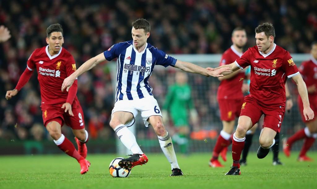 LIVERPOOL, ENGLAND - JANUARY 27: Jonny Evans of West Bromwich Albion holds off James Milner of Liverpool during The Emirates FA Cup Fourth Round match between Liverpool and West Bromwich Albion at Anfield on January 27, 2018 in Liverpool, England. (Photo by Alex Livesey/Getty Images)
