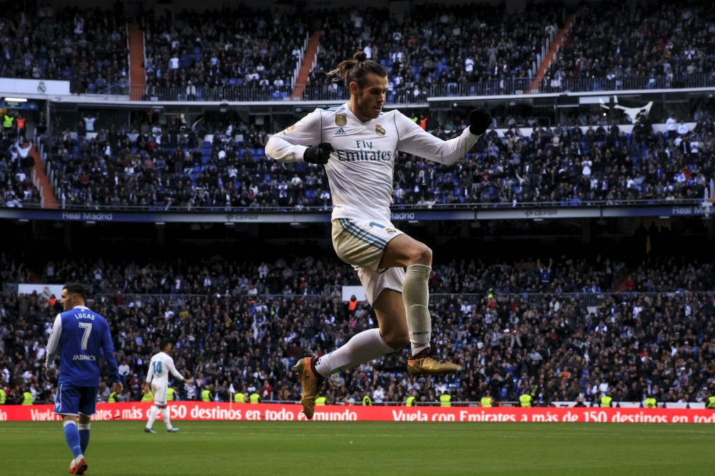 MADRID, SPAIN - JANUARY 21: Gareth Bale of Real Madrid CF celebrates scoring their third goal during the La Liga match between Real Madrid CF and Deportivo La Coruna at Estadio Santiago Bernabeu on January 21, 2018 in Madrid, Spain. (Photo by Gonzalo Arroyo Moreno/Getty Images)