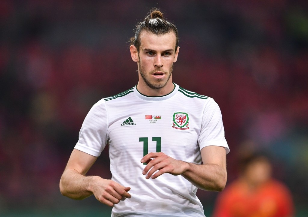Gareth Bale of Wales reacts during their China Cup International Football Championship Semi-final match against China in Nanning in China's southern Guangxi region on March 22, 2018. / AFP PHOTO / - / China OUT (Photo credit should read -/AFP/Getty Images)