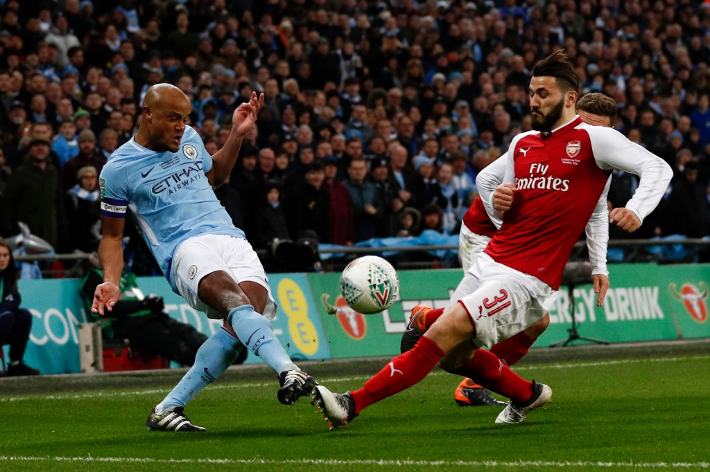 Manchester City's Belgian defender Vincent Kompany (L) vies with Arsenal's German-born Bosnian defender Sead Kolasinac during the English League Cup final football match between Manchester City and Arsenal at Wembley stadium in north London on February 25, 2018. / AFP PHOTO / Adrian DENNIS / RESTRICTED TO EDITORIAL USE. No use with unauthorized audio, video, data, fixture lists, club/league logos or 'live' services. Online in-match use limited to 75 images, no video emulation. No use in betting, games or single club/league/player publications. / (Photo credit should read ADRIAN DENNIS/AFP/Getty Images)