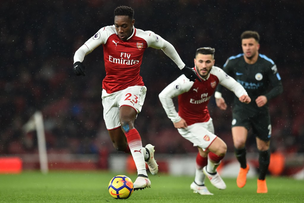 Arsenal's English striker Danny Welbeck runs with the ball during the English Premier League football match between Arsenal and Manchester City at the Emirates Stadium in London on March 1, 2018. / AFP PHOTO / Glyn KIRK / RESTRICTED TO EDITORIAL USE. No use with unauthorized audio, video, data, fixture lists, club/league logos or 'live' services. Online in-match use limited to 75 images, no video emulation. No use in betting, games or single club/league/player publications. / (Photo credit should read GLYN KIRK/AFP/Getty Images)