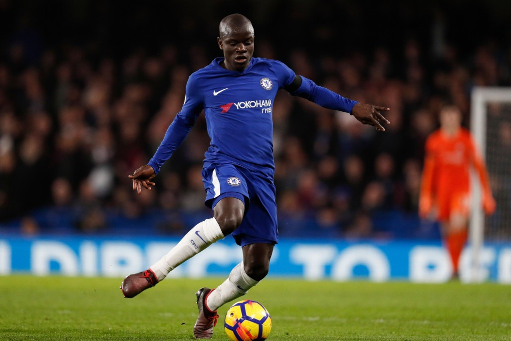 Chelsea's French midfielder N'Golo Kante plays the ball during the English Premier League football match between Chelsea and Crystal Palace at Stamford Bridge in London on March 10, 2018. / AFP PHOTO / Adrian DENNIS / RESTRICTED TO EDITORIAL USE. No use with unauthorized audio, video, data, fixture lists, club/league logos or 'live' services. Online in-match use limited to 75 images, no video emulation. No use in betting, games or single club/league/player publications. / (Photo credit should read ADRIAN DENNIS/AFP/Getty Images)