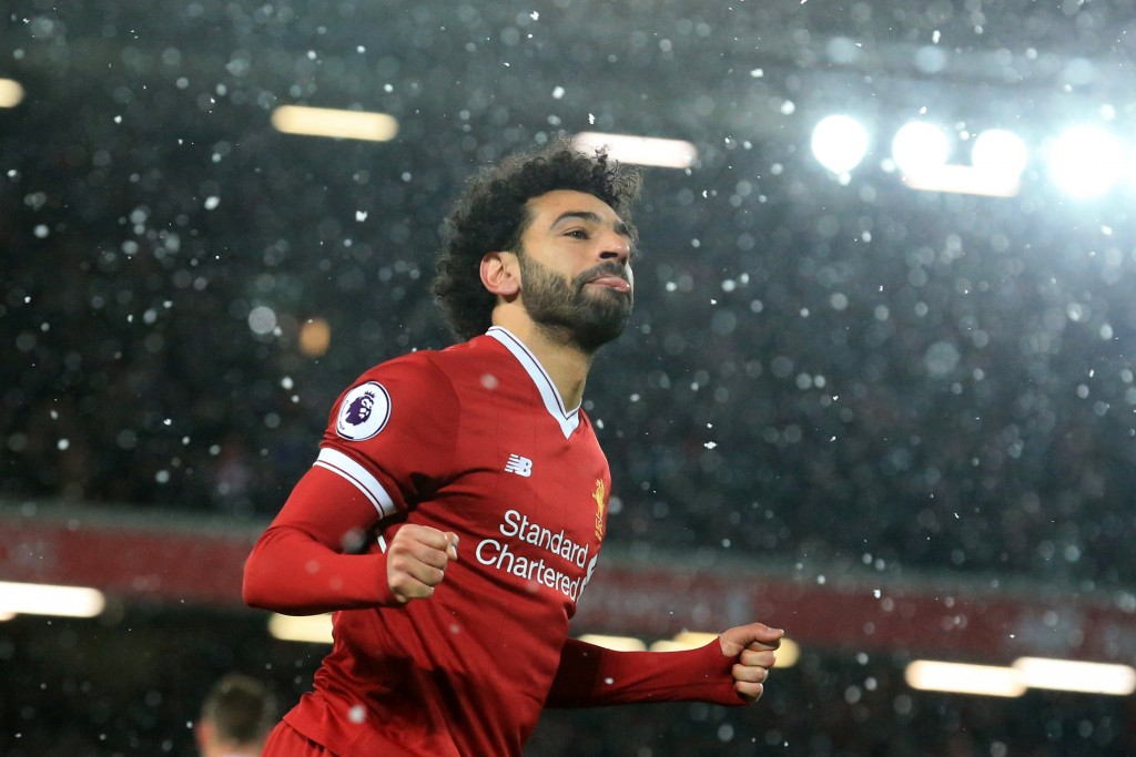 Liverpool's Egyptian midfielder Mohamed Salah celebrates scoring the team's fourth goal during the English Premier League football match between Liverpool and Watford at Anfield in Liverpool, north west England on March 17, 2018. / AFP PHOTO / Lindsey PARNABY / RESTRICTED TO EDITORIAL USE. No use with unauthorized audio, video, data, fixture lists, club/league logos or 'live' services. Online in-match use limited to 75 images, no video emulation. No use in betting, games or single club/league/player publications. / (Photo credit should read LINDSEY PARNABY/AFP/Getty Images)