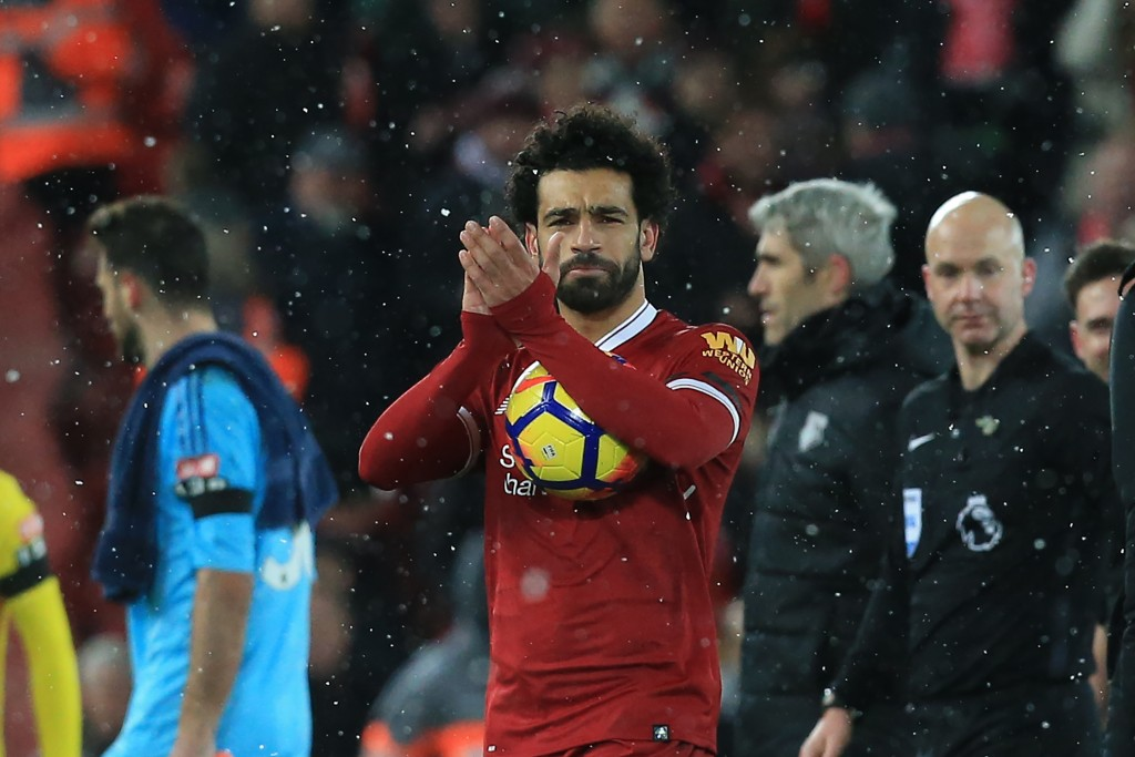Liverpool's Egyptian midfielder Mohamed Salah gestures after the English Premier League football match between Liverpool and Watford at Anfield in Liverpool, north west England on March 17, 2018. / AFP PHOTO / Lindsey PARNABY / RESTRICTED TO EDITORIAL USE. No use with unauthorized audio, video, data, fixture lists, club/league logos or 'live' services. Online in-match use limited to 75 images, no video emulation. No use in betting, games or single club/league/player publications. / (Photo credit should read LINDSEY PARNABY/AFP/Getty Images)