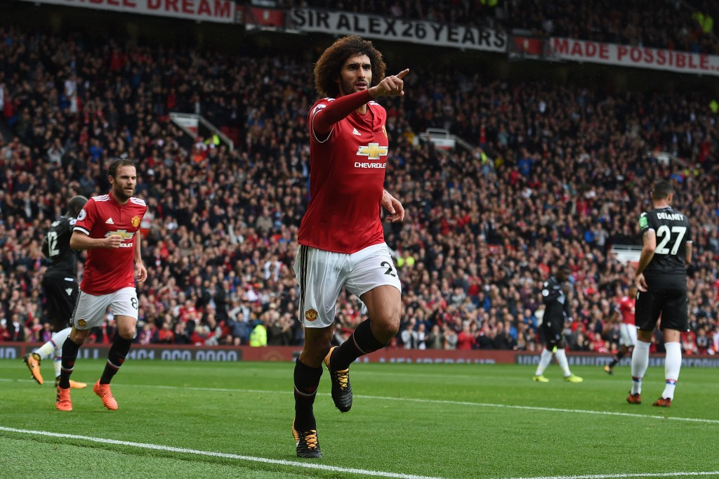 Manchester United's Belgian midfielder Marouane Fellaini celebrates scoring the team's second goal during the English Premier League football match between Manchester United and Crystal Palace at Old Trafford in Manchester, north west England, on September 30, 2017. / AFP PHOTO / PAUL ELLIS / RESTRICTED TO EDITORIAL USE. No use with unauthorized audio, video, data, fixture lists, club/league logos or 'live' services. Online in-match use limited to 75 images, no video emulation. No use in betting, games or single club/league/player publications. / (Photo credit should read PAUL ELLIS/AFP/Getty Images)