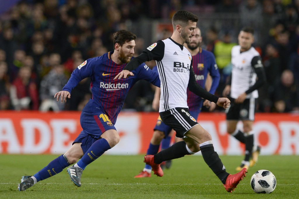 Barcelona's Argentinian forward Lionel Messi (L) vies with Valencia's Spanish defender Jose Luis Gaya Pena during the Spanish 'Copa del Rey' (King's cup) first leg semi-final football match between FC Barcelona and Valencia CF at the Camp Nou stadium in Barcelona on February 01, 2018. / AFP PHOTO / Josep LAGO (Photo credit should read JOSEP LAGO/AFP/Getty Images)
