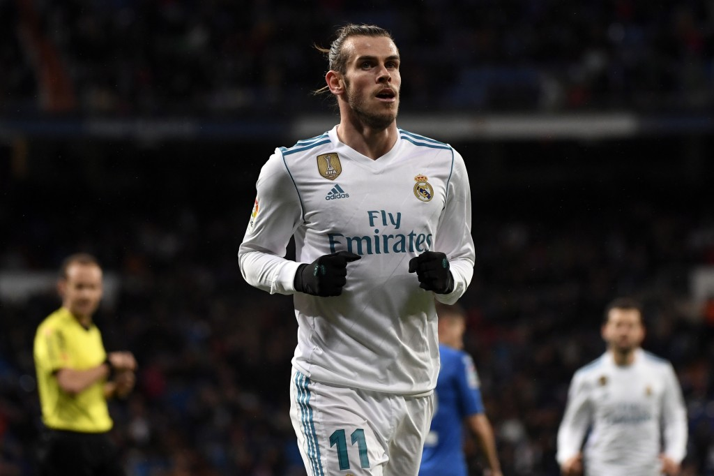 Real Madrid's Welsh forward Gareth Bale celebrates a goal during the Spanish league football match Real Madrid CF against Getafe CF at the Santiago Bernabeu stadium in Madrid on March 3, 2018. / AFP PHOTO / PIERRE-PHILIPPE MARCOU (Photo credit should read PIERRE-PHILIPPE MARCOU/AFP/Getty Images)