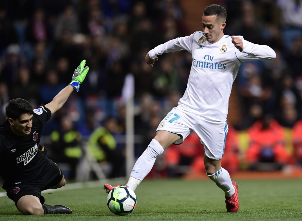 Real Madrid's Spanish midfielder Lucas Vazquez (R) vies with Girona's Moroccan goalkeeper Yassine Bounou during the Spanish League football match between Real Madrid CF and Girona FC at the Santiago Bernabeu stadium in Madrid on March 18, 2018. / AFP PHOTO / JAVIER SORIANO (Photo credit should read JAVIER SORIANO/AFP/Getty Images)