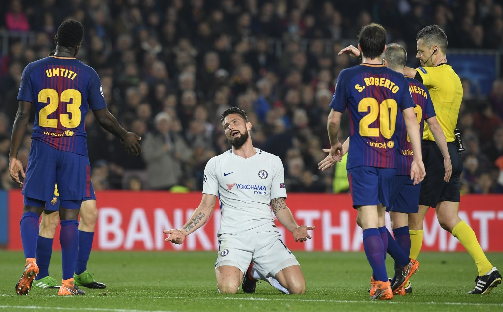 Chelsea's French attacker Olivier Giroud (C) talks to Barcelona's French defender Samuel Umtiti (L) during the UEFA Champions League round of sixteen second leg football match between FC Barcelona and Chelsea FC at the Camp Nou stadium in Barcelona on March 14, 2018. / AFP PHOTO / LLUIS GENE (Photo credit should read LLUIS GENE/AFP/Getty Images)
