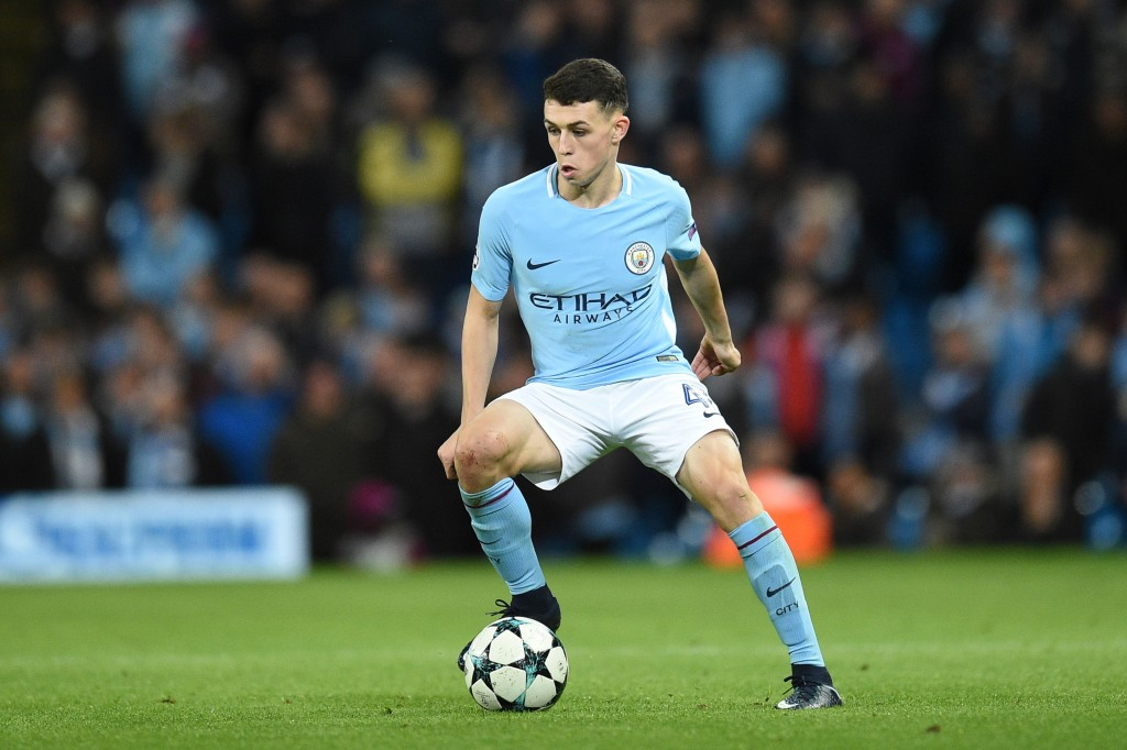 Manchester City's English midfielder Phil Foden controls the ball during the UEFA Champions League Group F football match between Manchester City and Feyenoord at the Etihad Stadium in Manchester, north west England, on November 21, 2017. / AFP PHOTO / Oli SCARFF (Photo credit should read OLI SCARFF/AFP/Getty Images)