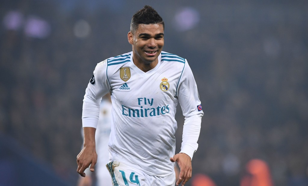 Real Madrid's Brazilian midfielder Casemiro celebrates after scoring his team's second goal during the UEFA Champions League round of 16 second leg football match between Paris Saint-Germain (PSG) and Real Madrid on March 6, 2018, at the Parc des Princes stadium in Paris. / AFP PHOTO / FRANCK FIFE (Photo credit should read FRANCK FIFE/AFP/Getty Images)