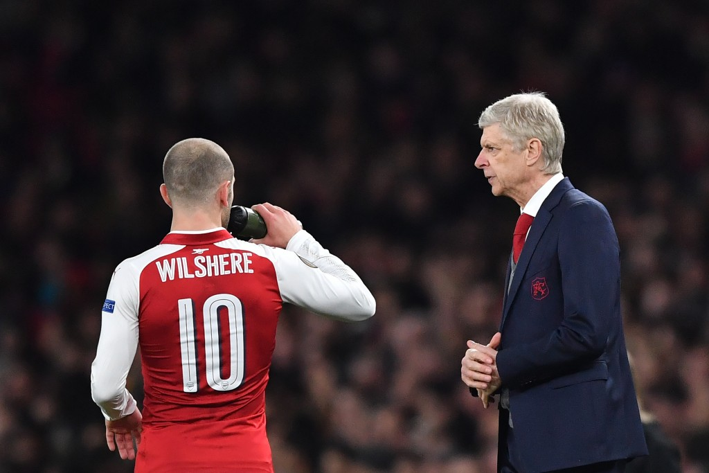 Arsenal's French manager Arsene Wenger (R) talks to Arsenal's English midfielder Jack Wilshere during the UEFA Europa League round of 16 second-leg football match between Arsenal and AC Milan at the Emirates Stadium in London on March 15, 2018. / AFP PHOTO / Ben STANSALL (Photo credit should read BEN STANSALL/AFP/Getty Images)
