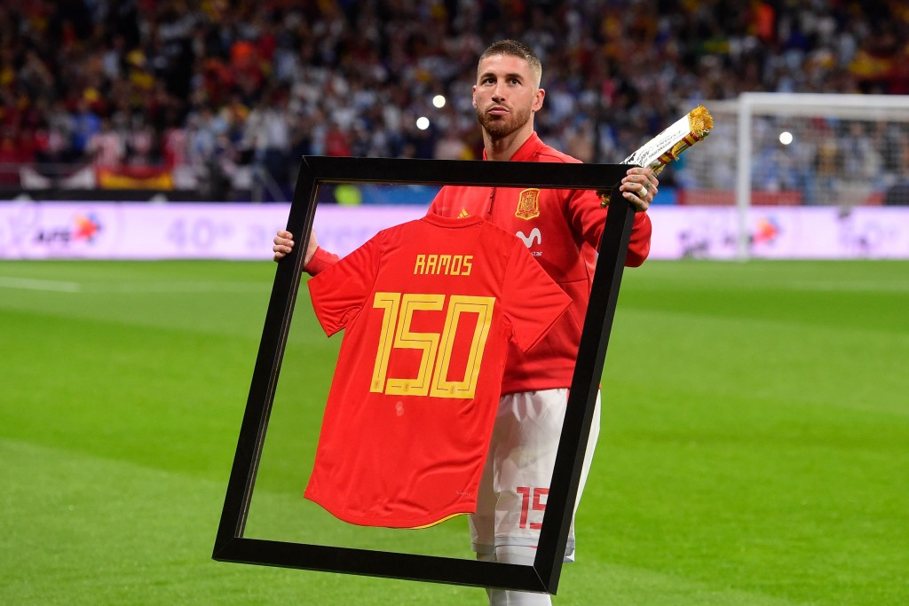 Spain's defender Sergio Ramos poses with a special framed jersey marking his 150th cap for Spain before a friendly football match between Spain and Argentina at the Wanda Metropolitano Stadium in Madrid on March 27, 2018. / AFP PHOTO / PIERRE-PHILIPPE MARCOU (Photo credit should read PIERRE-PHILIPPE MARCOU/AFP/Getty Images)