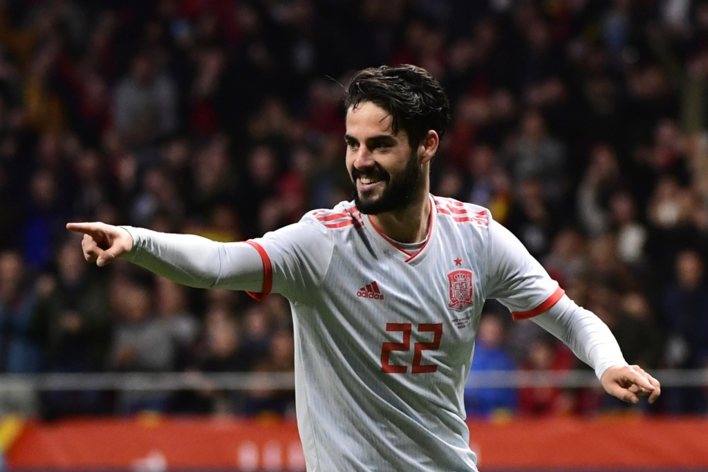Spain's midfielder Isco celebrates after scoring his team's third goal during a friendly football match between Spain and Argentina at the Wanda Metropolitano Stadium in Madrid on March 27, 2018. / AFP PHOTO / PIERRE-PHILIPPE MARCOU (Photo credit should read PIERRE-PHILIPPE MARCOU/AFP/Getty Images)