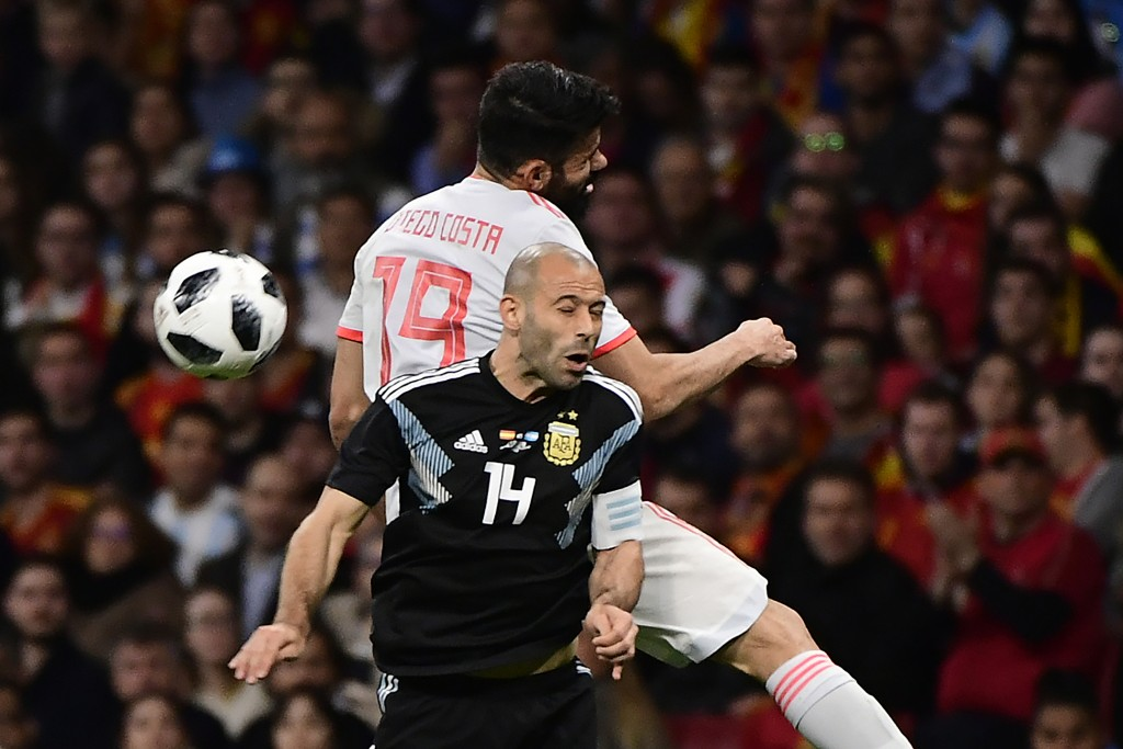 Spain's forward Diego Costa (back) heads the ball with Argentina's defender Javier Mascherano during a friendly football match between Spain and Argentina at the Wanda Metropolitano Stadium in Madrid on March 27, 2018. / AFP PHOTO / PIERRE-PHILIPPE MARCOU (Photo credit should read PIERRE-PHILIPPE MARCOU/AFP/Getty Images)