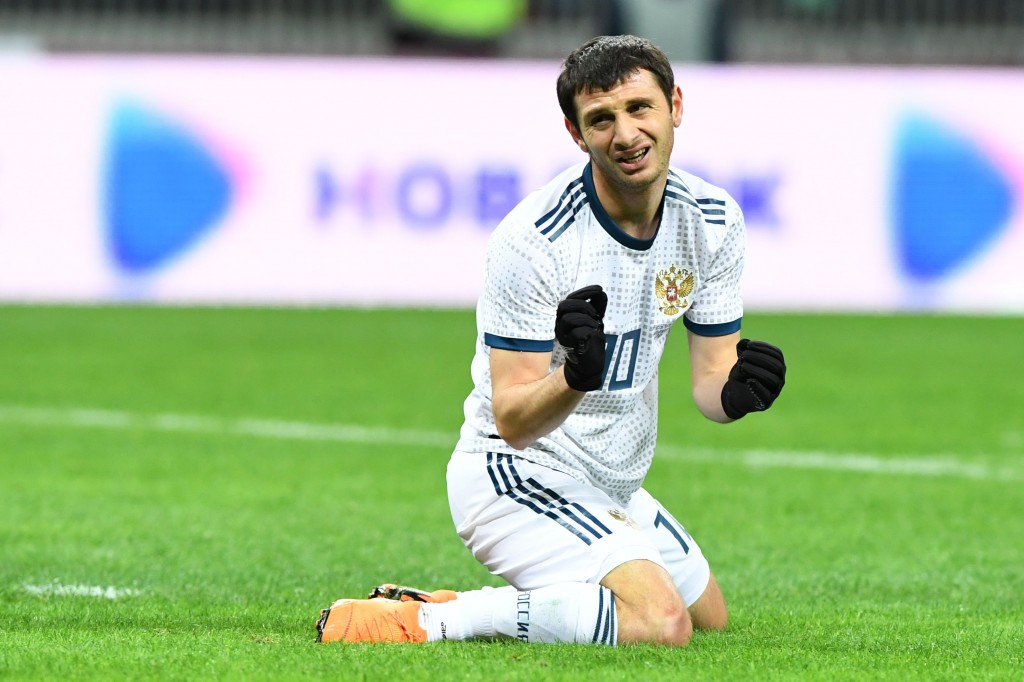Russia's midfielder Alan Dzagoev reacts during an international friendly football match between Russia and Brazil at the Luzhniki stadium in Moscow on March 23, 2018. / AFP PHOTO / Kirill KUDRYAVTSEV (Photo credit should read KIRILL KUDRYAVTSEV/AFP/Getty Images)