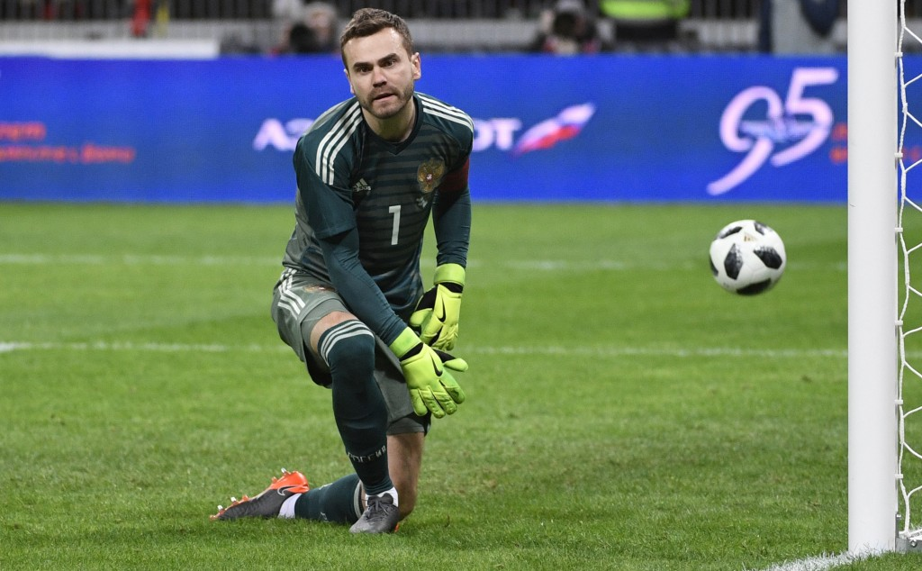 Russia's goalkeeper Igor Akinfeev reacts after failing to stop a goal from a penalty spot scored by Brazil's midfielder Philippe Coutinho during an international friendly football match between Russia and Brazil at the Luzhniki stadium in Moscow on March 23, 2018. / AFP PHOTO / Alexander NEMENOV (Photo credit should read ALEXANDER NEMENOV/AFP/Getty Images)