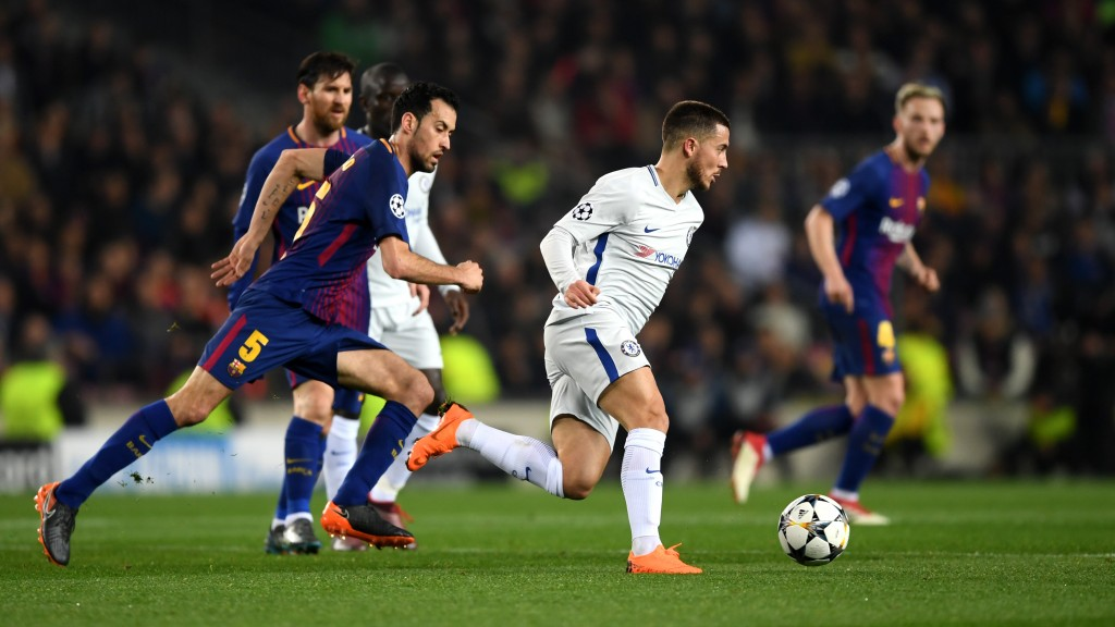 BARCELONA, SPAIN - MARCH 14: Eden Hazard of Chelsea attempts to get away from Sergio Busquets of Barcelona during the UEFA Champions League Round of 16 Second Leg match FC Barcelona and Chelsea FC at Camp Nou on March 14, 2018 in Barcelona, Spain. (Photo by Shaun Botterill/Getty Images)