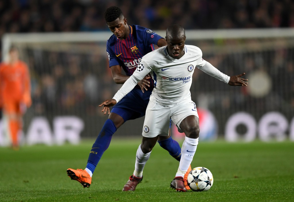 BARCELONA, SPAIN - MARCH 14: N'Golo Kante of Chelsea shields the ball from Ousmane Dembele of Barcelona during the UEFA Champions League Round of 16 Second Leg match FC Barcelona and Chelsea FC at Camp Nou on March 14, 2018 in Barcelona, Spain. (Photo by Shaun Botterill/Getty Images)