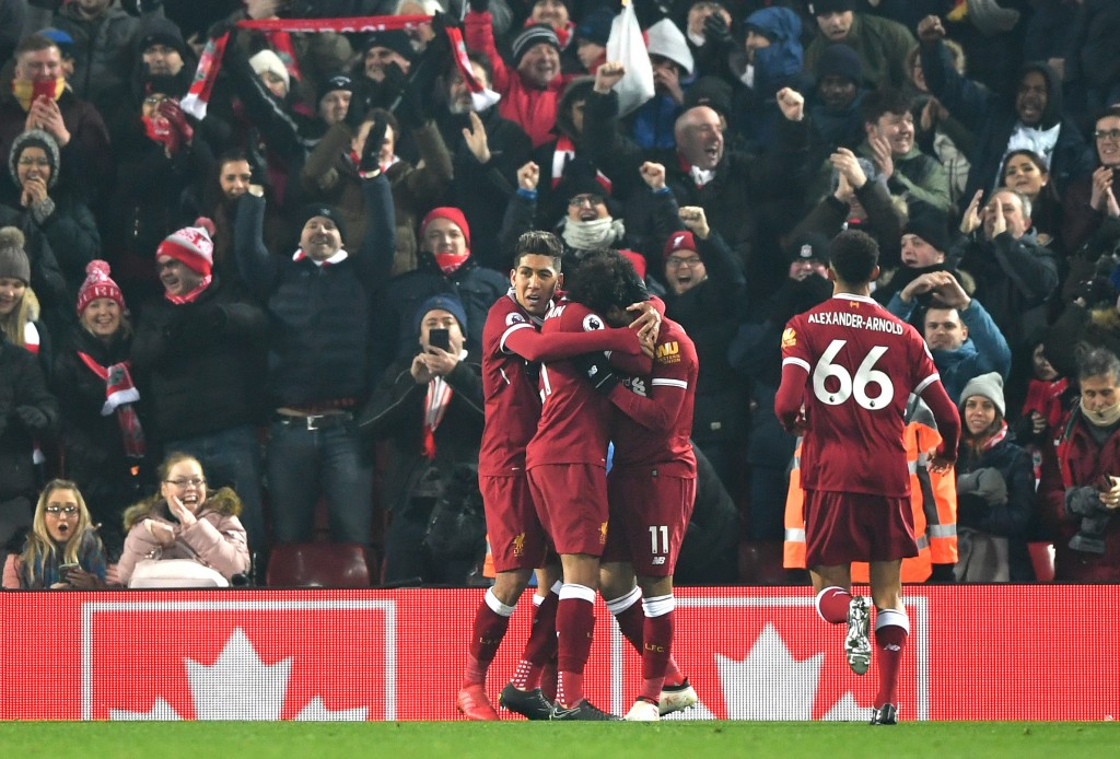 LIVERPOOL, ENGLAND - MARCH 03; Mohamed Salah of Liverpool celebrates with team mates after scoring his sides first goal during the Premier League match between Liverpool and Newcastle United at Anfield on March 3, 2018 in Liverpool, England. (Photo by Gareth Copley/Getty Images)