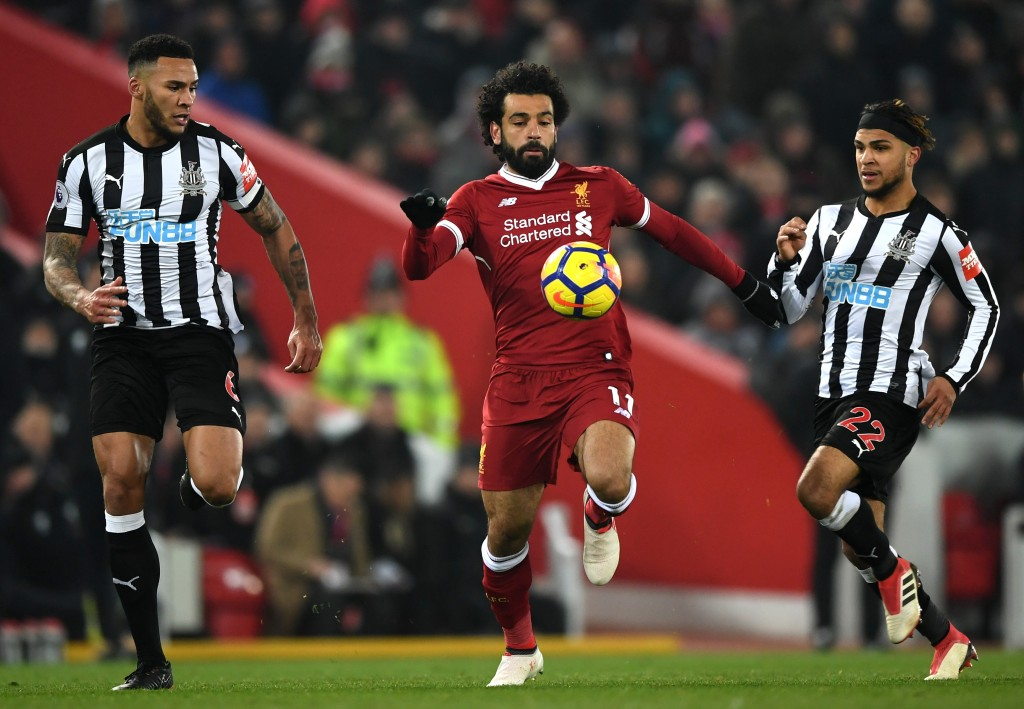 LIVERPOOL, ENGLAND - MARCH 03: Mohamed Salah of Liverpool is chased down by Jamaal Lascelles of Newcastle United during the Premier League match between Liverpool and Newcastle United at Anfield on March 3, 2018 in Liverpool, England. (Photo by Gareth Copley/Getty Images)