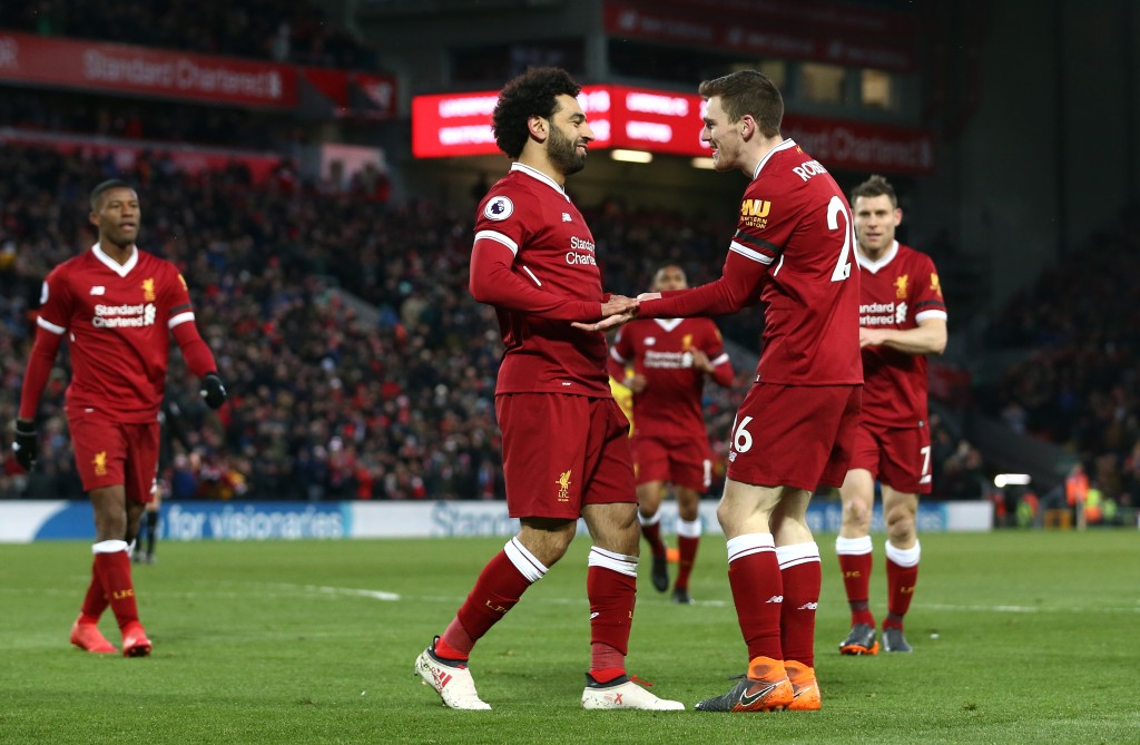LIVERPOOL, ENGLAND - MARCH 17: Mohamed Salah of Liverpool celebrates scoring his side's second goal with Andy Robertson during the Premier League match between Liverpool and Watford at Anfield on March 17, 2018 in Liverpool, England. (Photo by Jan Kruger/Getty Images)