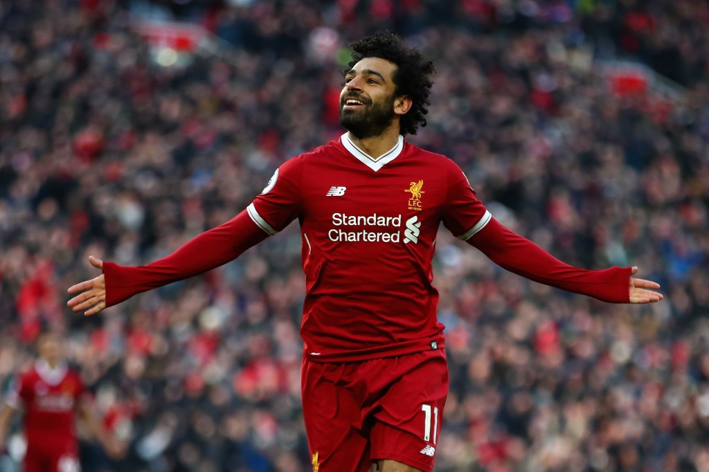 LIVERPOOL, ENGLAND - FEBRUARY 24: Mohamed Salah of Liverpool celebrates scoring his side's second goal during the Premier League match between Liverpool and West Ham United at Anfield on February 24, 2018 in Liverpool, England. (Photo by Clive Brunskill/Getty Images)
