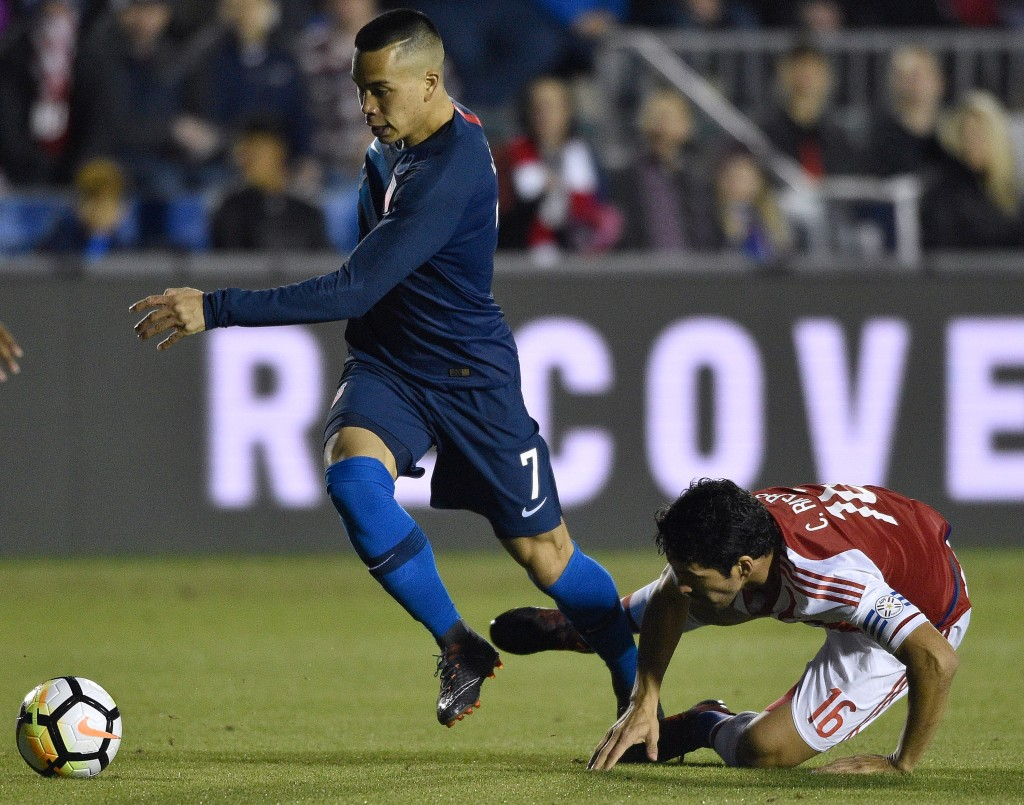 CARY, NC - MARCH 27: Bobby Wood #7 of United States battles Cristian Riveros #16 of Paraguay for the ball during their game at WakeMed Soccer Park on March 27, 2018 in Cary, North Carolina. (Photo by Grant Halverson/Getty Images)