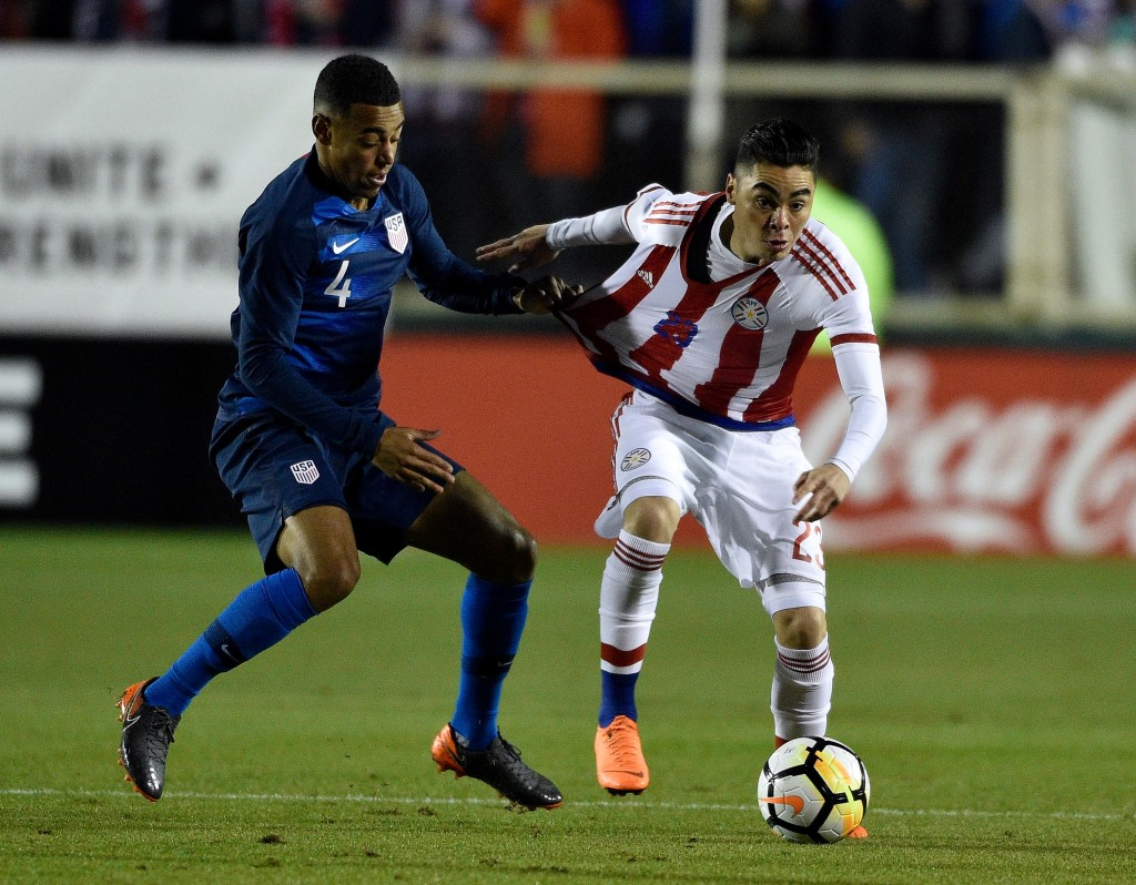 CARY, NC - MARCH 27: Tyler Adams #4 of United States grabs Miguel Almiron #23 of Paraguay as they battle for the ball during their game at WakeMed Soccer Park on March 27, 2018 in Cary, North Carolina. (Photo by Grant Halverson/Getty Images)