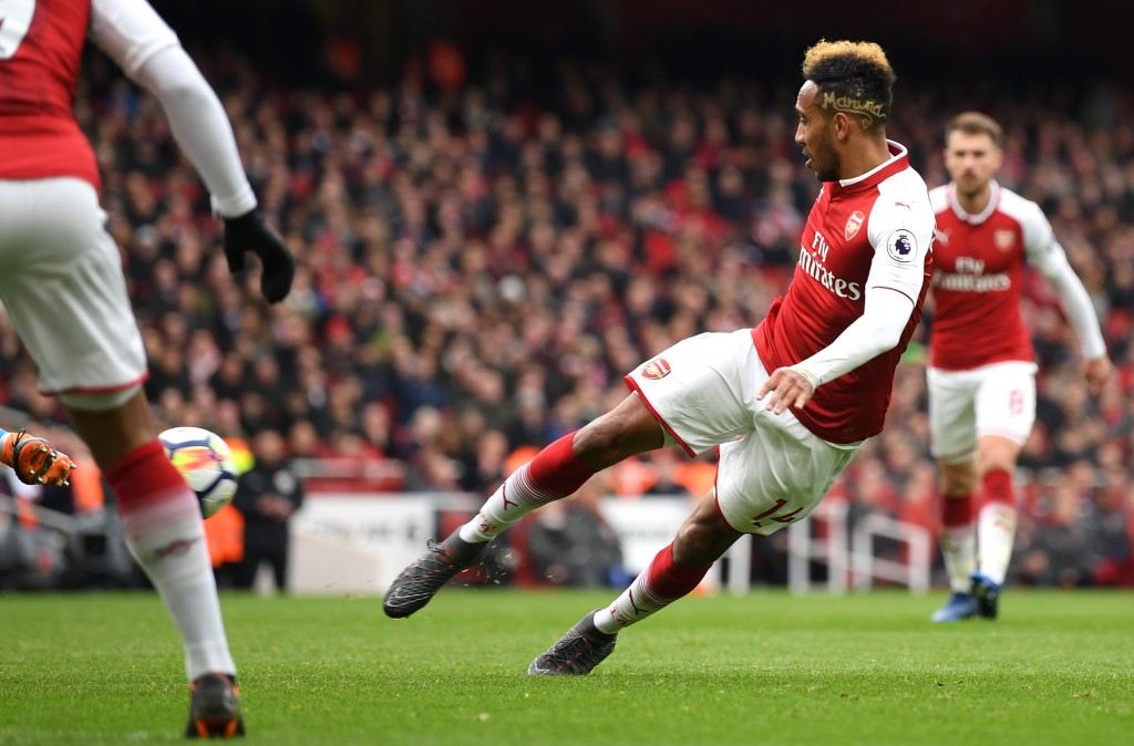 LONDON, ENGLAND - APRIL 01: Pierre-Emerick Aubameyang of Arsenal scores his sides second goal during the Premier League match between Arsenal and Stoke City at Emirates Stadium on April 1, 2018 in London, England. (Photo by Shaun Botterill/Getty Images)