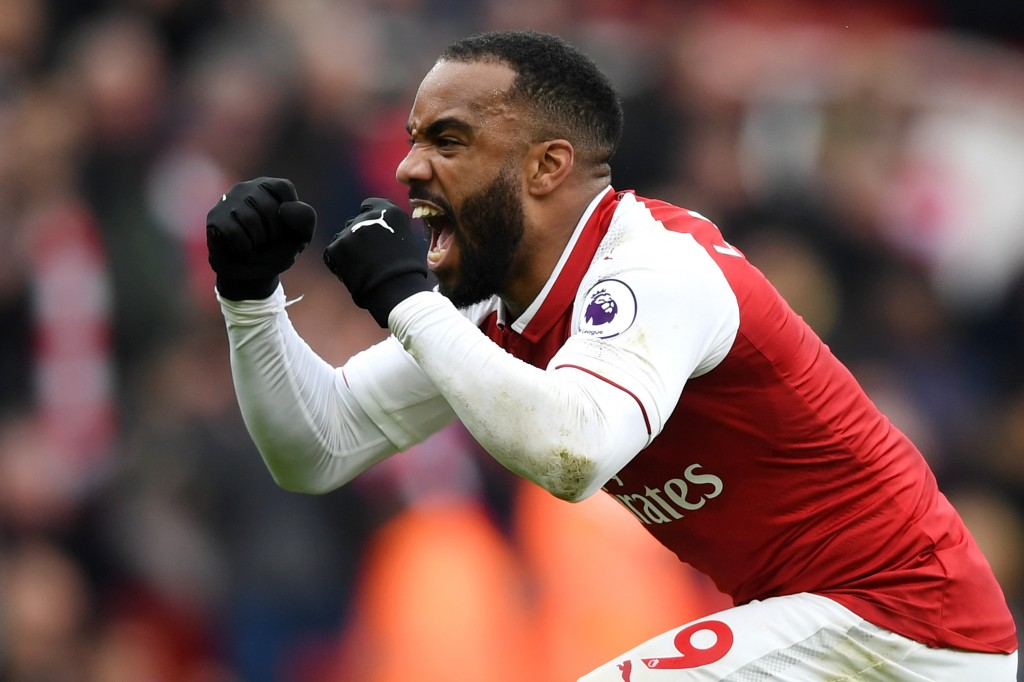LONDON, ENGLAND - APRIL 01: Alexandre Lacazette of Arsenal celebrates after scoring his sides third goal during the Premier League match between Arsenal and Stoke City at Emirates Stadium on April 1, 2018 in London, England. (Photo by Shaun Botterill/Getty Images)