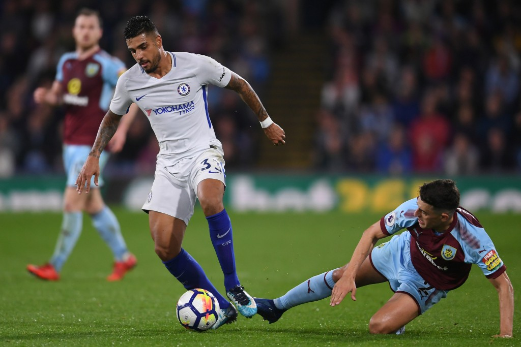 BURNLEY, ENGLAND - APRIL 19: Matthew Lowton of Burnley tackles Emerson Palmieri of Chelsea during the Premier League match between Burnley and Chelsea at Turf Moor on April 19, 2018 in Burnley, England. (Photo by Laurence Griffiths/Getty Images)