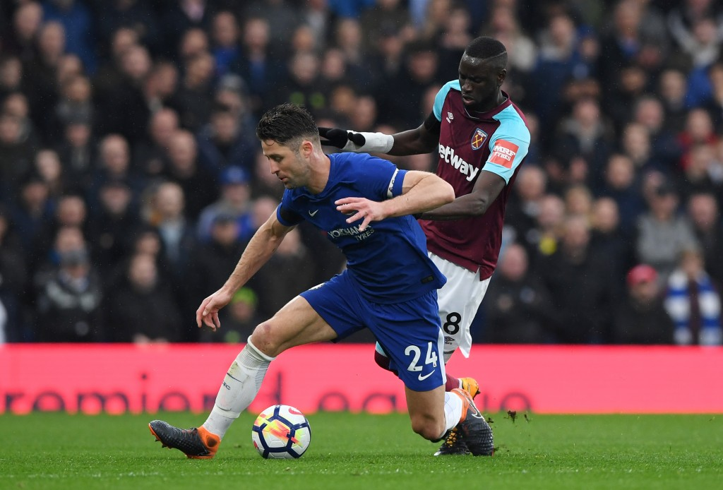 LONDON, ENGLAND - APRIL 08: Gary Cahill of Chelsea and Cheikhou Kouyate of West Ham United battle for possession during the Premier League match between Chelsea and West Ham United at Stamford Bridge on April 8, 2018 in London, England. (Photo by Shaun Botterill/Getty Images)