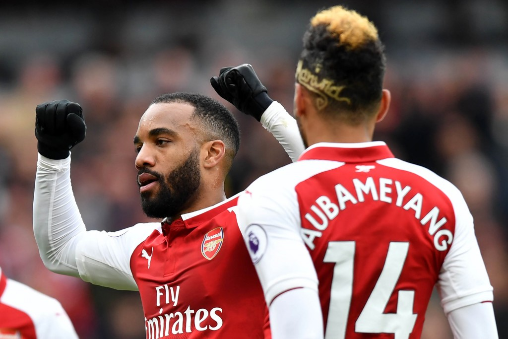 Arsenal's French striker Alexandre Lacazette (L) celerates scoring the team's third goal during the English Premier League football match between Arsenal and Stoke City at the Emirates Stadium in London on April 1, 2018. / AFP PHOTO / Oliver GREENWOOD / RESTRICTED TO EDITORIAL USE. No use with unauthorized audio, video, data, fixture lists, club/league logos or 'live' services. Online in-match use limited to 75 images, no video emulation. No use in betting, games or single club/league/player publications. / (Photo credit should read OLIVER GREENWOOD/AFP/Getty Images)