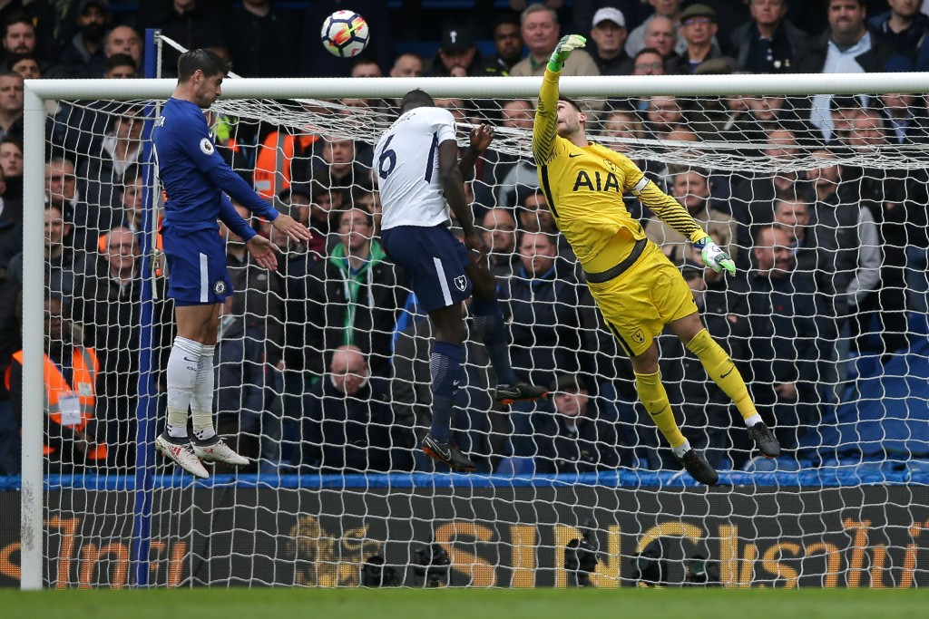 Tottenham Hotspur's French goalkeeper Hugo Lloris (R) fails to get to the ball as Chelsea's Spanish striker Alvaro Morata (L) jumps to head the opening goal of the English Premier League football match between Chelsea and Tottenham Hotspur at Stamford Bridge in London on April 1, 2018. / AFP PHOTO / Daniel LEAL-OLIVAS / RESTRICTED TO EDITORIAL USE. No use with unauthorized audio, video, data, fixture lists, club/league logos or 'live' services. Online in-match use limited to 75 images, no video emulation. No use in betting, games or single club/league/player publications. / (Photo credit should read DANIEL LEAL-OLIVAS/AFP/Getty Images)