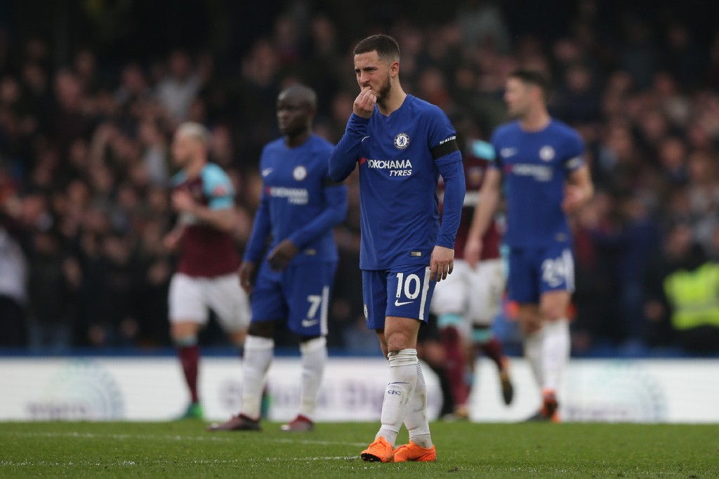 Chelsea's Belgian midfielder Eden Hazard reacts after they concede the Wets Ham goal during the English Premier League football match between Chelsea and West Ham United at Stamford Bridge in London on April 8, 2018. / AFP PHOTO / Daniel LEAL-OLIVAS / RESTRICTED TO EDITORIAL USE. No use with unauthorized audio, video, data, fixture lists, club/league logos or 'live' services. Online in-match use limited to 75 images, no video emulation. No use in betting, games or single club/league/player publications. / (Photo credit should read DANIEL LEAL-OLIVAS/AFP/Getty Images)