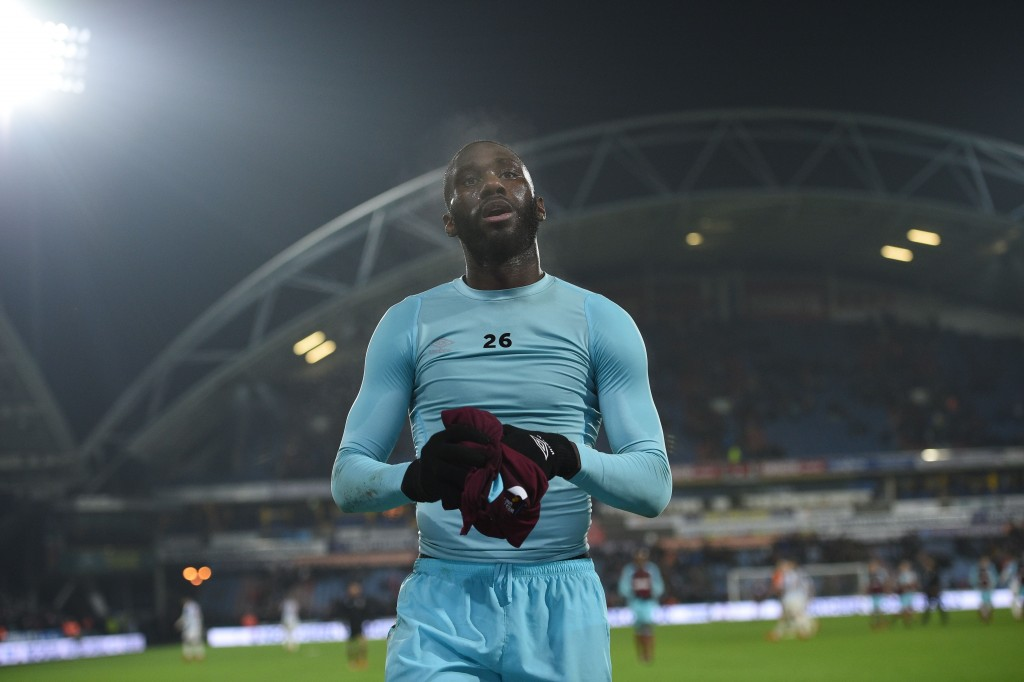 West Ham United's French defender Arthur Masuaku throws his shirt into the crowd after the final whistle during the English Premier League football match between Huddersfield Town and West Ham United at the John Smith's stadium in Huddersfield, northern England on January 13, 2018. / AFP PHOTO / Oli SCARFF / RESTRICTED TO EDITORIAL USE. No use with unauthorized audio, video, data, fixture lists, club/league logos or 'live' services. Online in-match use limited to 75 images, no video emulation. No use in betting, games or single club/league/player publications. / (Photo credit should read OLI SCARFF/AFP/Getty Images)