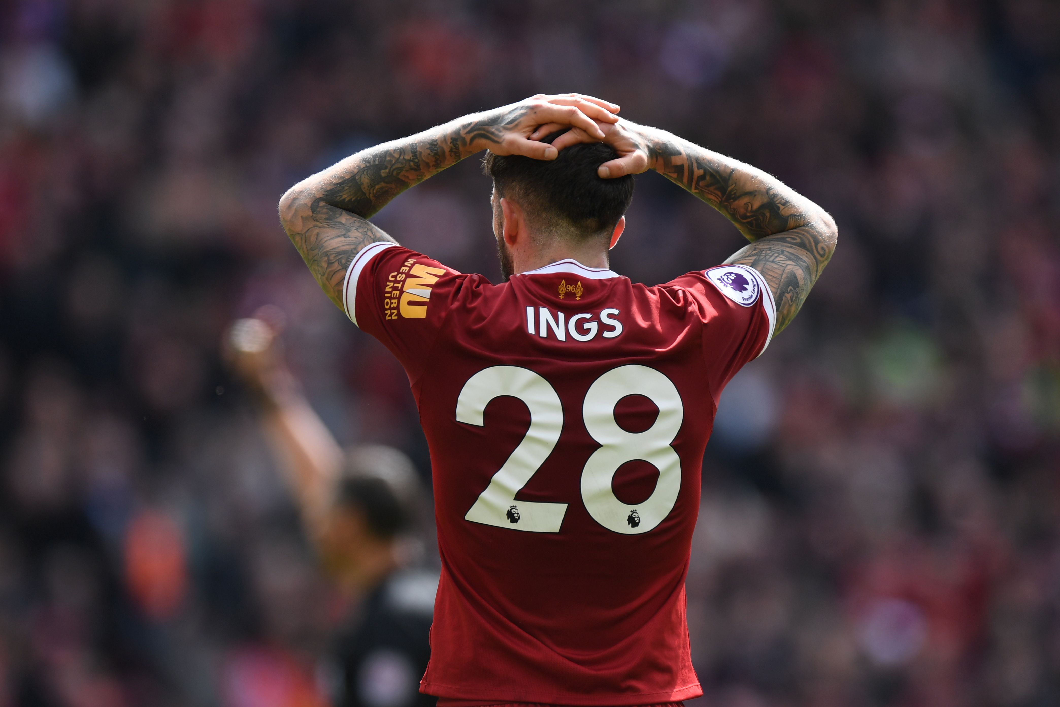 Liverpool's English striker Danny Ings reacts to his shot at goal ruled off-side during the English Premier League football match between Liverpool and Stoke City at Anfield in Liverpool, north west England on April 28, 2018. (Photo by Paul ELLIS / AFP) / RESTRICTED TO EDITORIAL USE. No use with unauthorized audio, video, data, fixture lists, club/league logos or 'live' services. Online in-match use limited to 75 images, no video emulation. No use in betting, games or single club/league/player publications. / (Photo credit should read PAUL ELLIS/AFP/Getty Images)