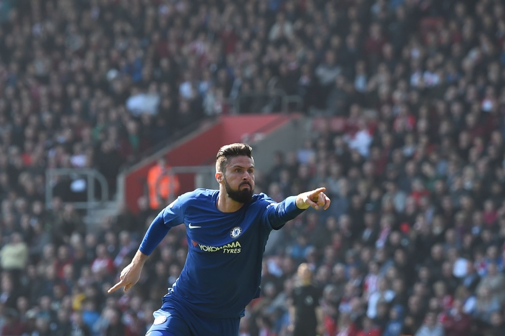 Chelsea's French attacker Olivier Giroud celebrates scoring their third goal during the English Premier League football match between Southampton and Chelsea at St Mary's Stadium in Southampton, southern England on April 14, 2018. / AFP PHOTO / Glyn KIRK / RESTRICTED TO EDITORIAL USE. No use with unauthorized audio, video, data, fixture lists, club/league logos or 'live' services. Online in-match use limited to 75 images, no video emulation. No use in betting, games or single club/league/player publications. / (Photo credit should read GLYN KIRK/AFP/Getty Images)