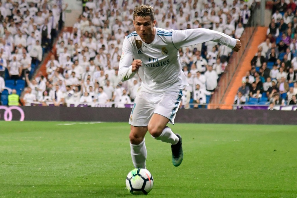 Real Madrid's Portuguese forward Cristiano Ronaldo runs with the ball during the Spanish league football match Real Madrid CF against Athletic Club Bilbao at the Santiago Bernabeu stadium in Madrid on April 18, 2018. / AFP PHOTO / JAVIER SORIANO (Photo credit should read JAVIER SORIANO/AFP/Getty Images)