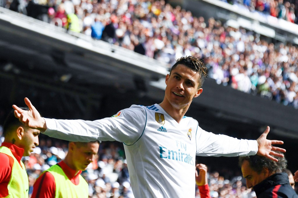 Real Madrid's Portuguese forward Cristiano Ronaldo celebrates after scoring a goal during the Spanish league football match between Real Madrid CF and Club Atletico de Madrid at the Santiago Bernabeu stadium in Madrid on April 8, 2018. / AFP PHOTO / GABRIEL BOUYS (Photo credit should read GABRIEL BOUYS/AFP/Getty Images)