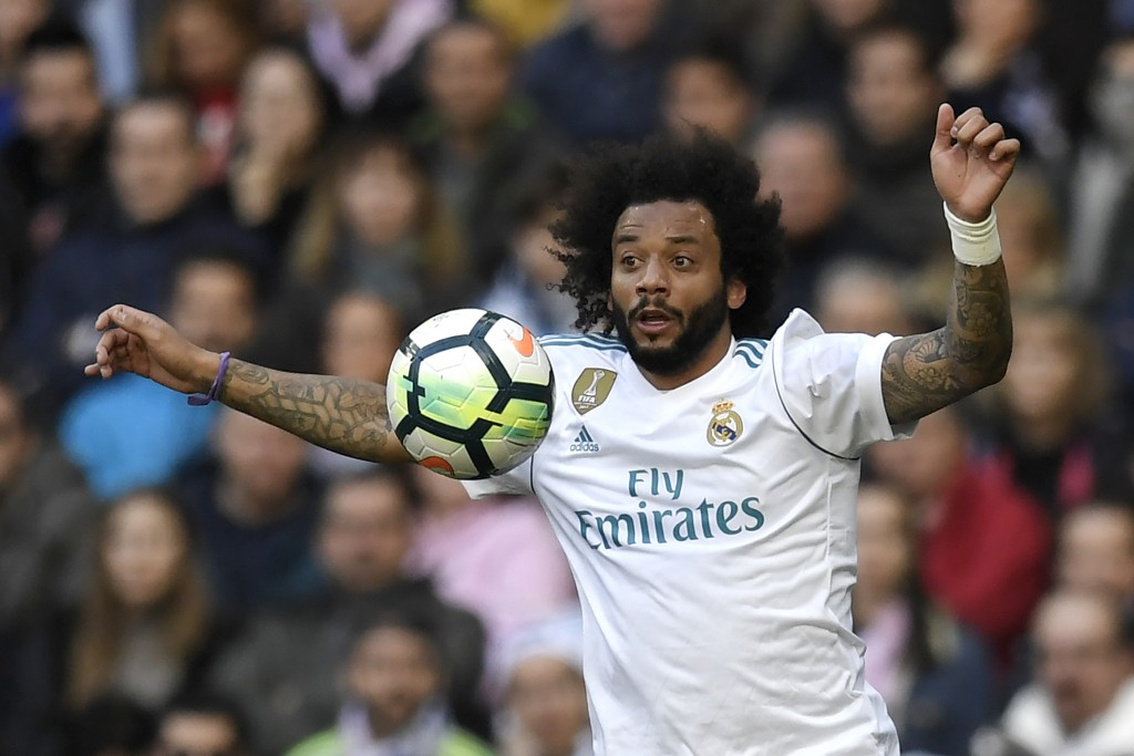 Real Madrid's Brazilian defender Marcelo controls the ball during the Spanish league football match between Real Madrid CF and Club Atletico de Madrid at the Santiago Bernabeu stadium in Madrid on April 8, 2018. / AFP PHOTO / GABRIEL BOUYS (Photo credit should read GABRIEL BOUYS/AFP/Getty Images)