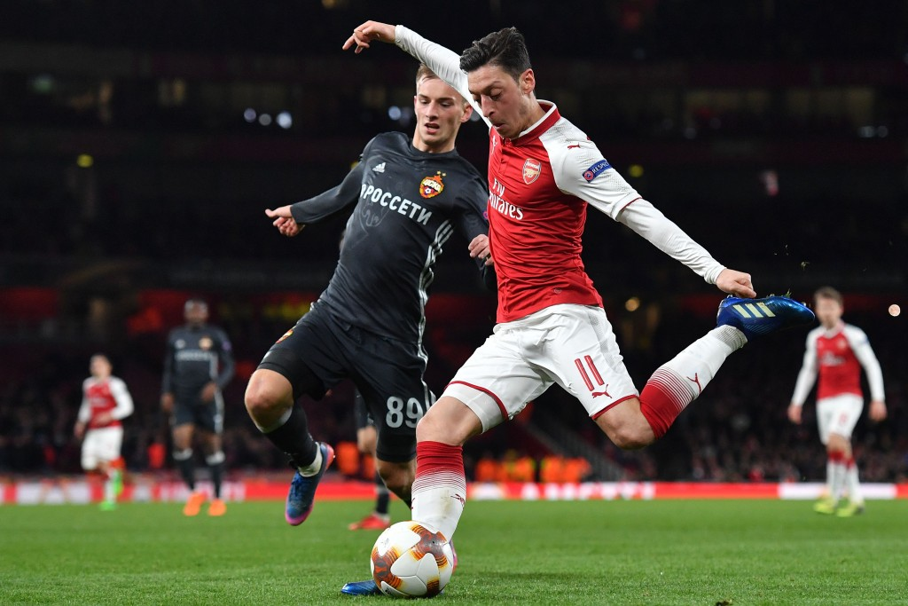 Arsenal's German midfielder Mesut Ozil crosses the ball during the UEFA Europa League first leg quarter-final football match between Arsenal and CSKA Moscow at the Emirates Stadium in London on April 5, 2018. / AFP PHOTO / Ben STANSALL (Photo credit should read BEN STANSALL/AFP/Getty Images)