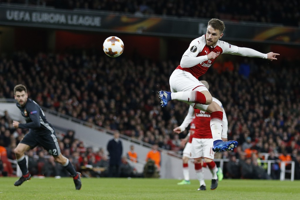 Arsenal's Welsh midfielder Aaron Ramsey scores their third goal with this flick during the UEFA Europa League first leg quarter-final football match between Arsenal and CSKA Moscow at the Emirates Stadium in London on April 5, 2018. / AFP PHOTO / IKIMAGES / Ian KINGTON (Photo credit should read IAN KINGTON/AFP/Getty Images)