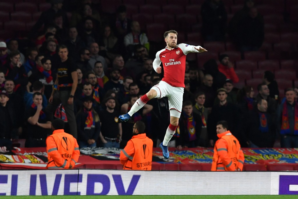 Arsenal's Welsh midfielder Aaron Ramsey celebrates after scoring their third goal during the UEFA Europa League first leg quarter-final football match between Arsenal and CSKA Moscow at the Emirates Stadium in London on April 5, 2018. / AFP PHOTO / Ben STANSALL (Photo credit should read BEN STANSALL/AFP/Getty Images)