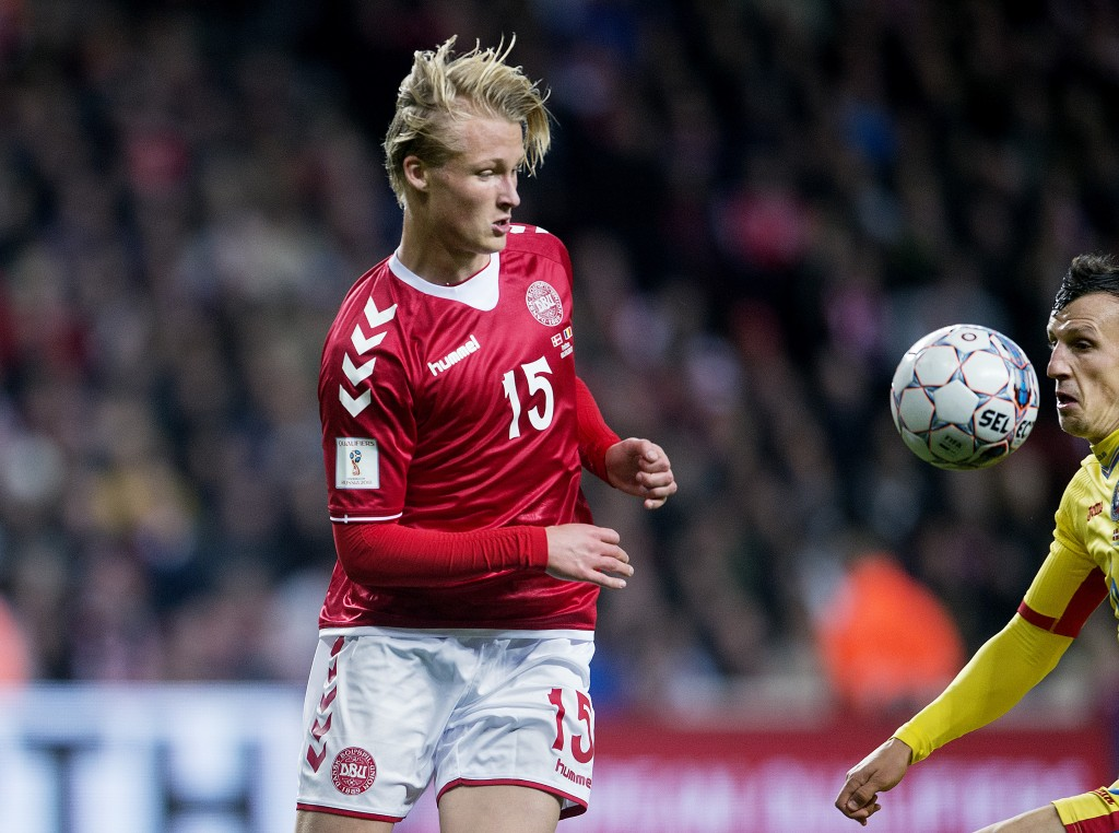 Denmark's forward Kasper Dolberg vies with Romania's Vlad Chiriches during the FIFA World Cup 2018 qualification football match between Denmark and Romania in Copenhagen on October 8, 2017. / AFP PHOTO / Scanpix Denmark AND Scanpix / Liselotte Sabroe / Denmark OUT (Photo credit should read LISELOTTE SABROE/AFP/Getty Images)